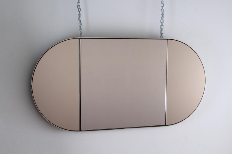 Elegant and beautiful piece design. In brown wood, brass and oval mirror opening on the sides Wear consistent with age and use.