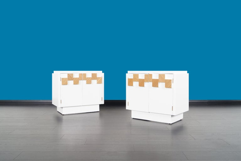 A stunning pair of vintage Brutalist mosaic nightstands manufactured by Lane in the United States. Each table comes with two doors and a fixed shelf inside, all integrated with geometric shapes on the front side. Its versatility allows it to serve