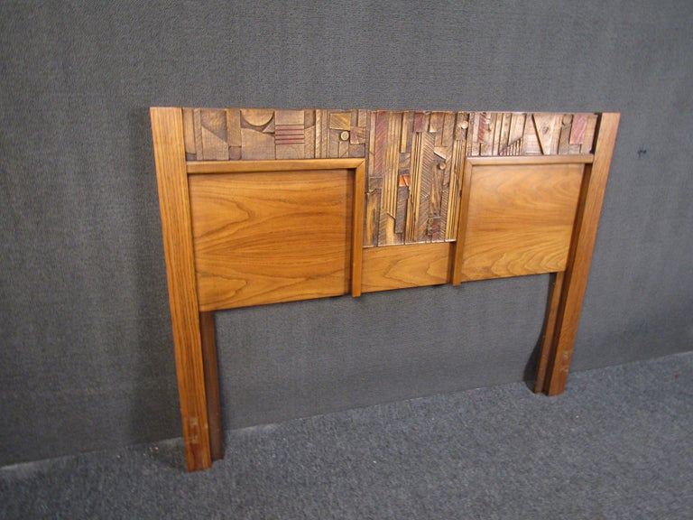 Brutalist wooden headboard by Lane Furniture that is sure to add character to any bedroom with its eye-catching assortment of sculpted details. Please confirm item location with seller (NY or NJ).