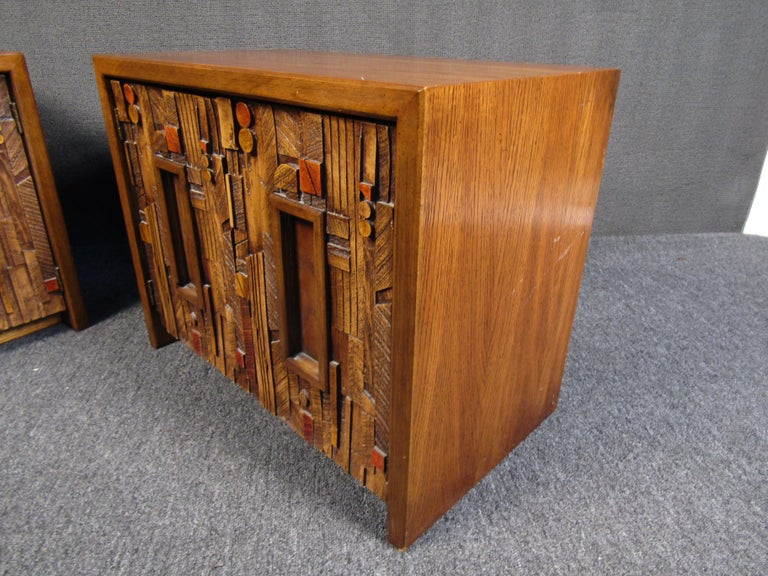Pair of Brutalist wooden nightstands by Lane that are sure to add character to any bedroom with their eye-catching assortment of sculpted details. One shelf in each night stand allows for storage and organization. Please confirm item location with