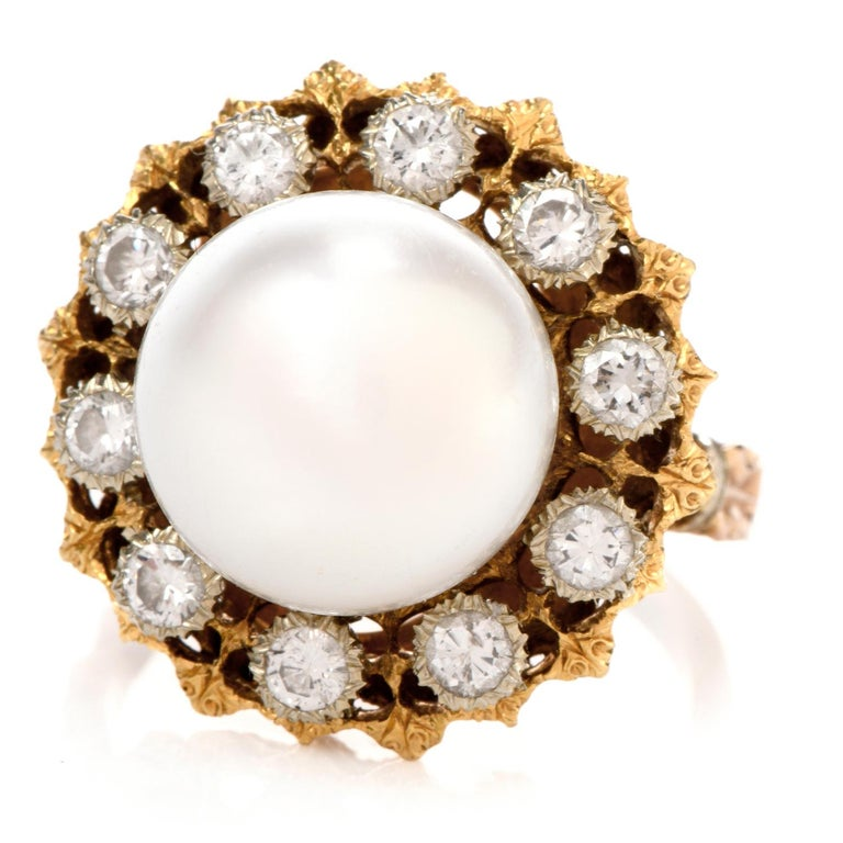 This Vinatge Buccellati Diamond and Pearl ring was inspired by a natural flower motif  and crafted with 9.8 grams of 18k gold.  The style features a soft whitish pink white colored pearl measuring approximately 13mm in diameter and is surrounded by