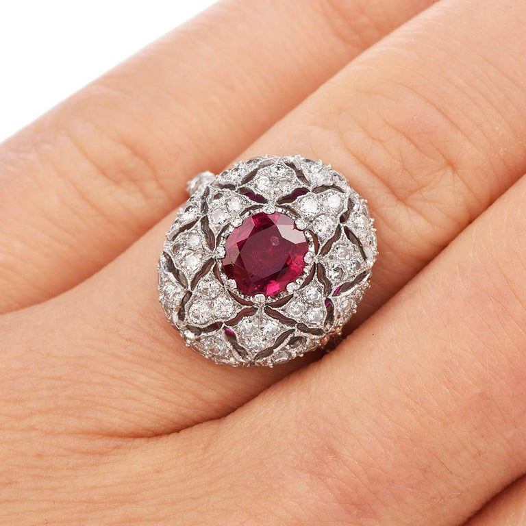 Perfection is the word to describe this detailed Vintage Buccellati  Ruby and Diamond Ring with an approx. total weight of 5.5 grams.  Mastercrafted in solid Platinum, adorned with Vibrant Genuine Natural Red Ruby round-cut, prong-set with an
