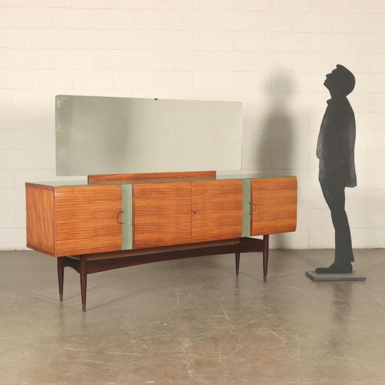 Buffet with mirror; veneer, back-treated glass, synthetic leather inserts, brass.