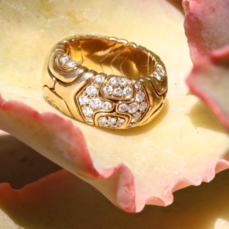 Vintage 1989 Bulgari diamond 18k ring. With 56 round brilliant diamonds that weigh approximately 1.10 carats, graded E-F color, VVS clarity.  Jack Weir & Sons Flawless Protection Plan:  7 day return policy for full cash refund 30 day return for