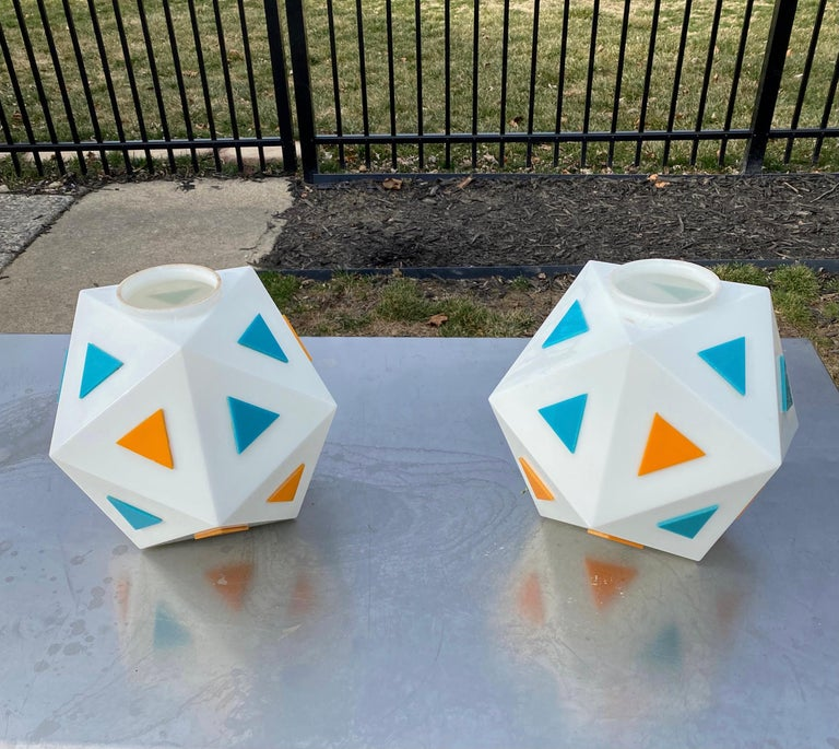 Genuine treasure from America's burger wars of the 1960's, we have two of these opaque white glass globes from the iconic Burger Chef restaurants purchased directly from one of their earliest employees.  Each globe is an icosahedron (20 triangular
