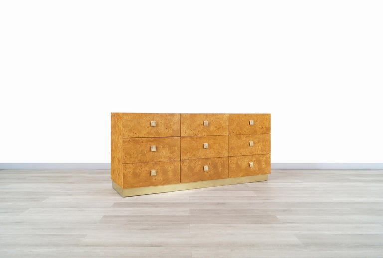 Wonderful vintage burl wood and brass dresser manufactured by Founders in the United States, circa 1980s. This dresser is inspired by the iconic designs of the famous designer Milo Baughman. This collection was characterized by having fine furniture