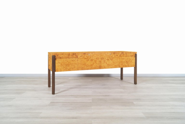 Exceptional vintage burl wood and bronze credenza in the manner of Pace, circa 1970s. Features four elegant drawers of different sizes, each drawer has aluminum rails which makes it easier to move when opening and closing the drawers. The drawers do