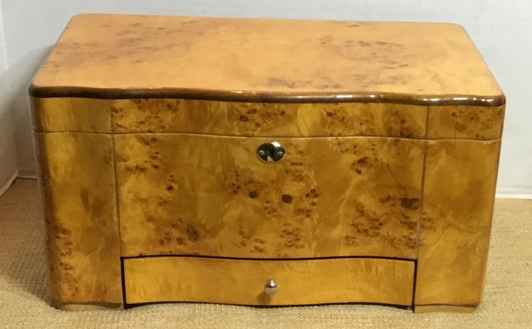A Classic burr elm humidor made of cedar-lined interior with three compartments, heavy top cover