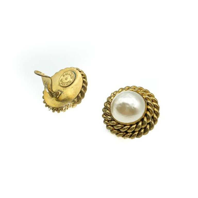 Vintage Butler and Wilson Earrings. Crafted in gold plated brass with a large central glass simulated half maybe pearl. In very good vintage condition, signed, 3.2cms. These are a stunning pair of high quality clip-ons from Butler & Wilson that will