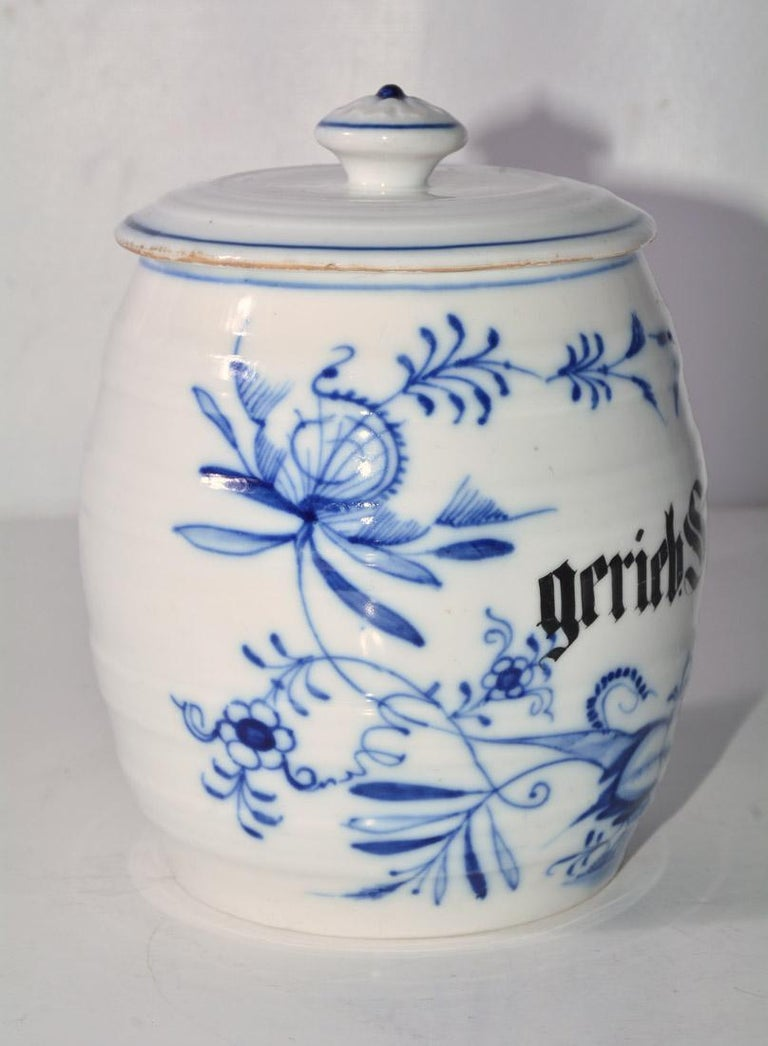 Vintage German blue floral and white canister labeled Gerieb Semel. Barrel shape and lid.