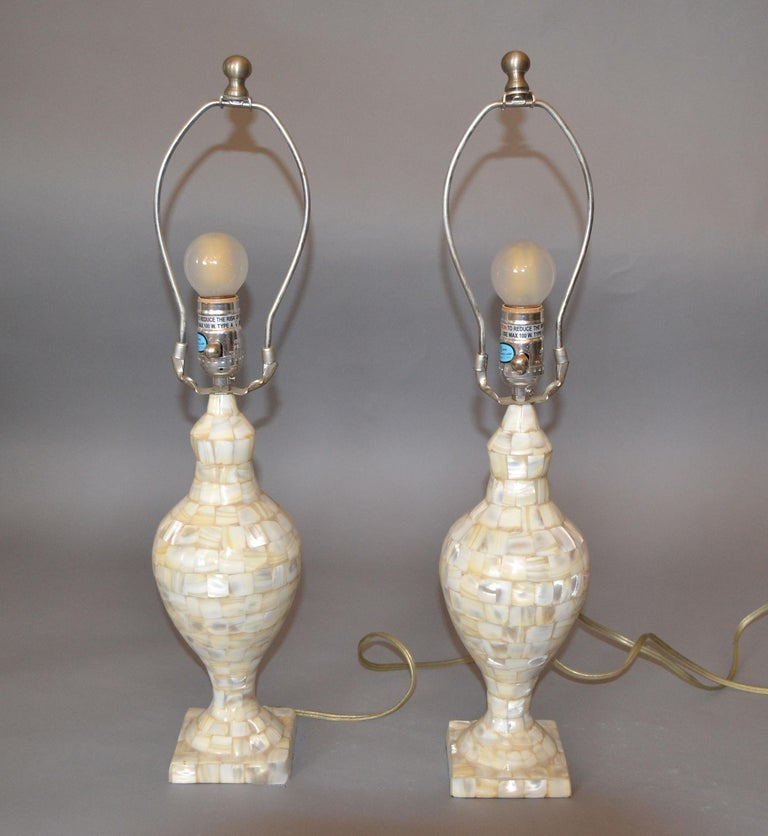 A pair of vintage capiz shell table lamps. Perfect working condition and each uses a max. 60 watts light bulb. The set comes with harp, finial and original shades.   Measurement shade: Height 9 inches, diameter 12 inches.