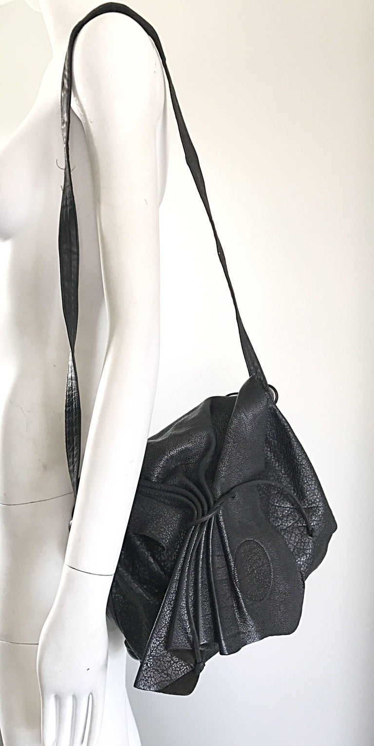 Chic and classic signature CARLOS FALCHI black buffalo leather shoulder bag or crossbody messenger bag! The strap is long enough to function as either. Buffalo leather is one of the toughest leathers out there, so this makes for the perfect everyday