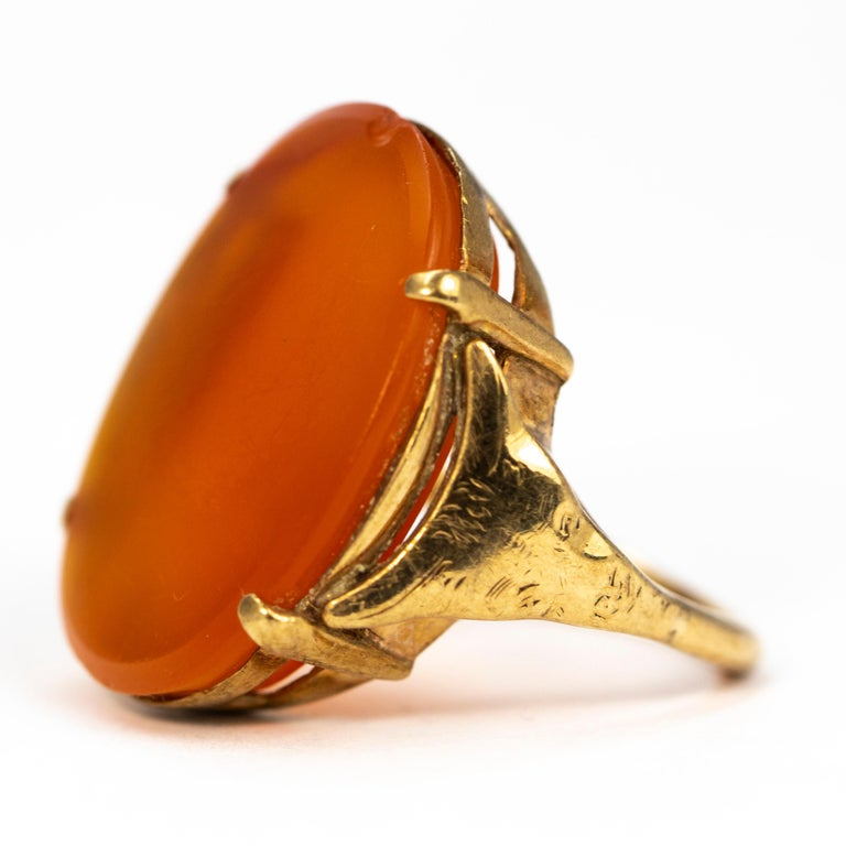The giant carnelian stone in this ring is gorgeous, glossy and a pretty deep orange colour. The size of the stone is sure to grab some attention! It is held within four delicate claws which let the stone really speak for itself!  Ring Size: M 1/2 or