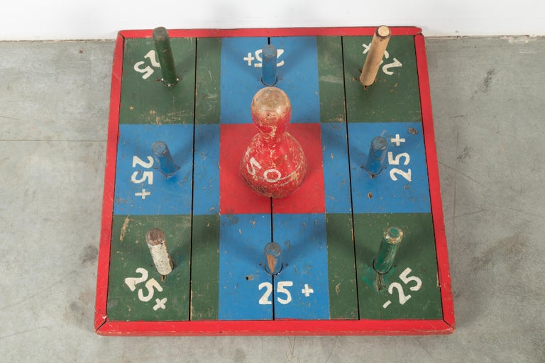 Great vintage carnival midway ring toss game. Perfect wall art. Wood with original park paint surface. These appear to be one of a kind carnie made pieces for a traveling carnival. Bonus points when you get your ring on the center pin. Less points