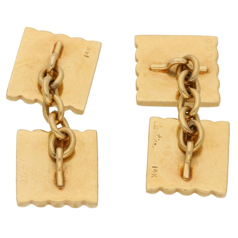 A classic pair of vintage Cartier cufflinks dating back to the elegant 1940's when men's jewelry nearly disappeared during the war years, although the military had a strong influence on design post war.  They were almost always worn with dress