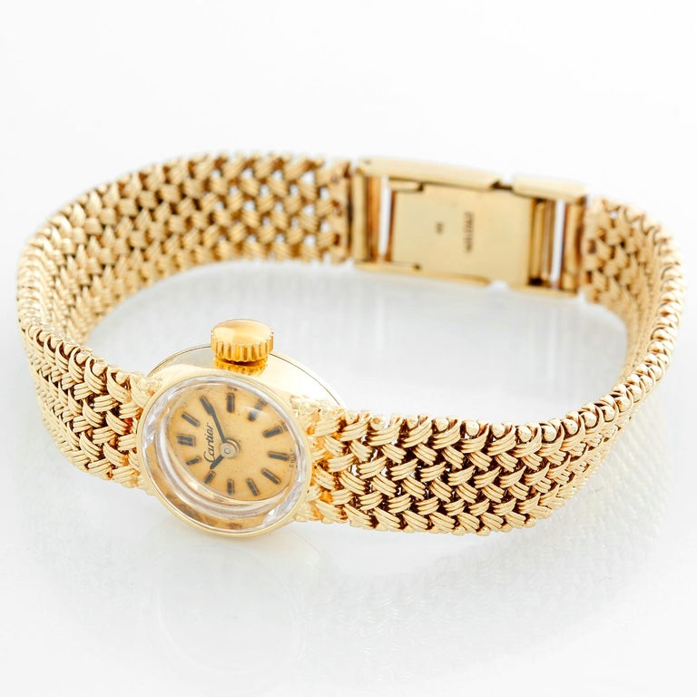 Vintage Cartier 18K Yellow Gold Ladies Watch - Mechanical. 18K Yellow gold case (15 mm ). Champagne dial with stick hour markers. 18K Yellow gold mesh bracelet; will fit a 6 1/2 inch wrist. Pre-owned with Cartier box .