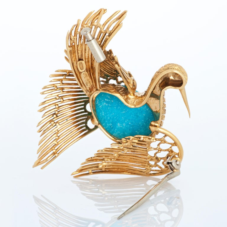 Vintage Cartier 18k yellow gold swan / bird brooch with an oval cabochon turquoise body and faceted ruby eye. 13.90 grams.  Measures 1.63