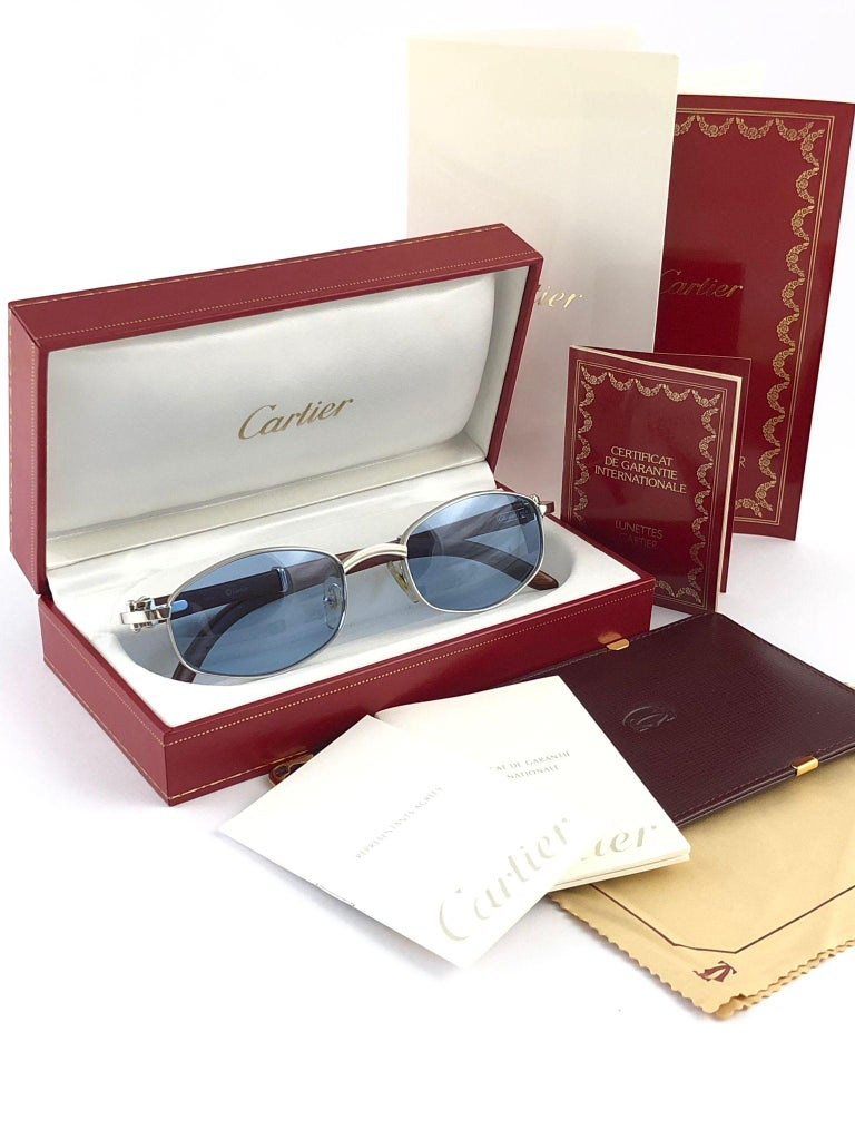New 1990 Cartier Full Set Cartayat Hardwood Sunglasses with new light blue  (uv protection) lenses.  Frame is with the front and sides in white gold and has the famous wood & gold accents temples.  Amazing craftsmanship! All hallmarks. Both arms