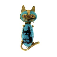 Vintage Cartier Cat 2-Stone Matrix Turquoise with Ruby Eyes Gold Brooch