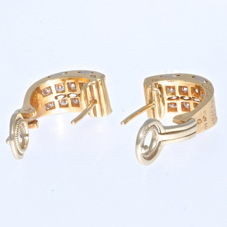 These vintage Cartier earrings are absolutely tres chic and timeless. Their size and universal design make them the perfect everyday accessory. Whether you have short or long hairstyle, these will not go unnoticed and the top quality diamonds will