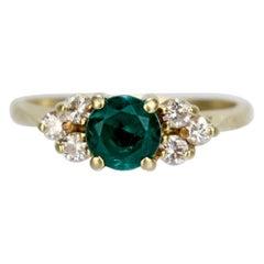 Vintage Cartier Emerald, Diamond, and 18 Karat Gold Cocktail Ring