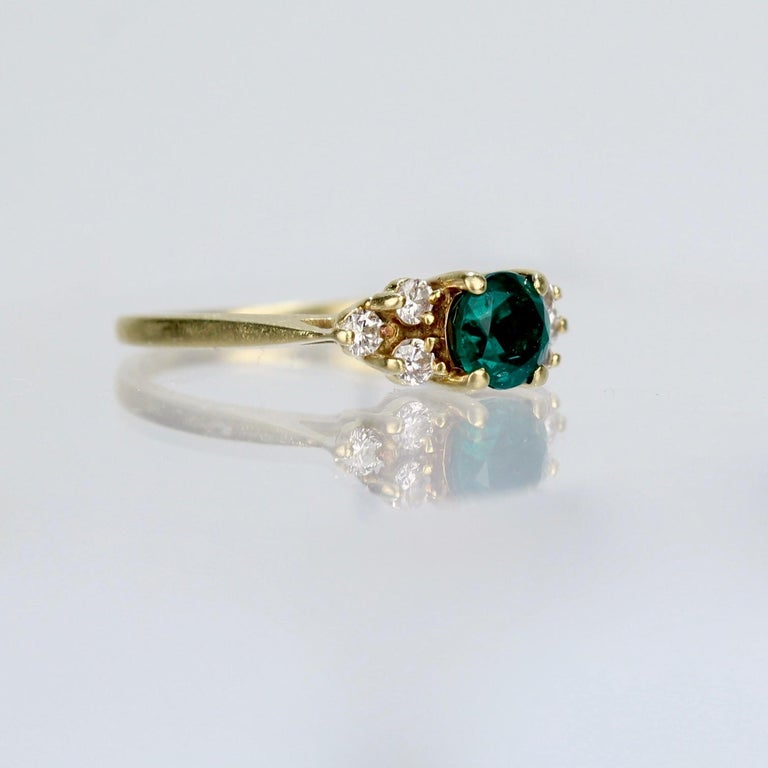 Vintage Cardow Emerald, Diamond, and 18 Karat Gold Cocktail Ring In Good Condition For Sale In Philadelphia, PA
