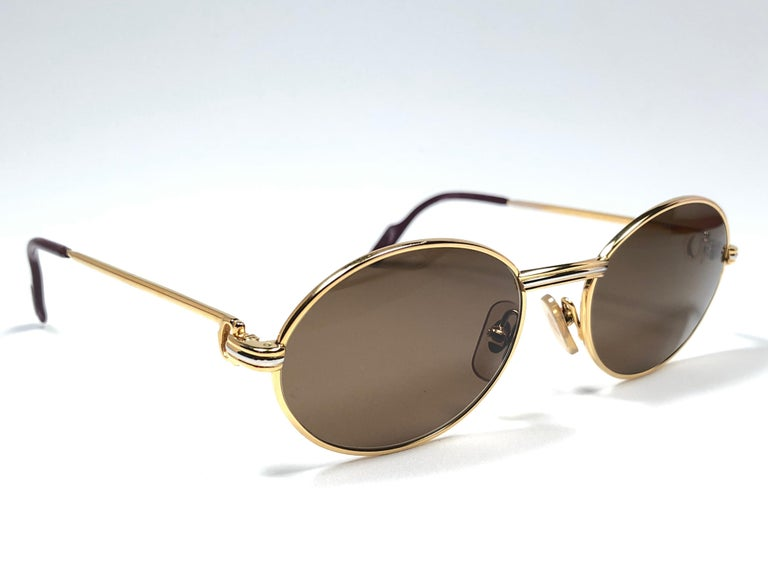 a6fb95248b867 Vintage Cartier oval St Honore sunglasses. All hallmarks. Cartier signs on  the ear paddles