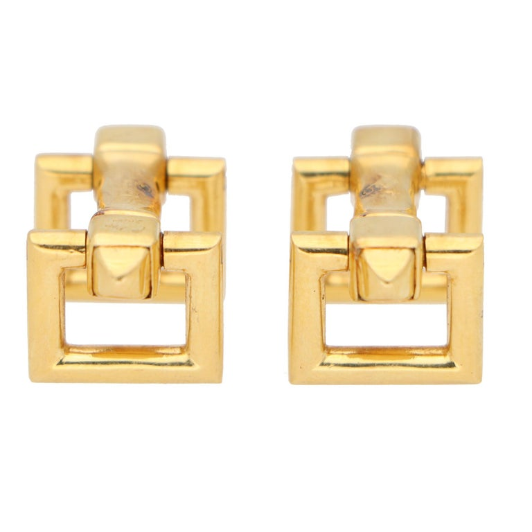 A stylish pair of vintage Cartier snaffle bar cufflinks set in solid 18k yellow gold.   These cufflinks display classic Cartier elegance with Art Deco inspired terminals to either end. The cufflinks can be easily put on with a snap click fitting.