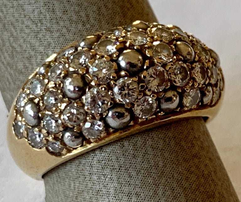 This gorgeous 18K yellow gold ring by Cartier is a mix of allure and glamour! The incredibly fabulous ring is  pave set with Diamonds that make the ring absolutely sublime. Signed and numbered.  Ring Top Dimensions: 24mm x 12mm.  The ring is