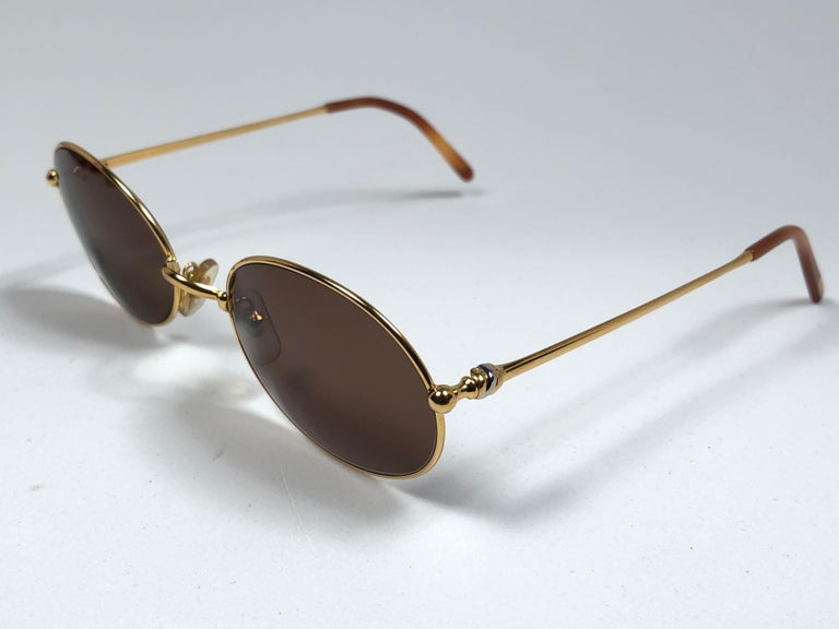 Vintage Cartier Saturne Gold Plated Solid Brown Lens France 1990 Sunglasse In New Condition For Sale In Amsterdam, Noord Holland