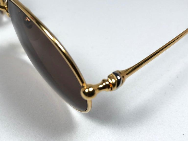 Women's or Men's Vintage Cartier Saturne Gold Plated Solid Brown Lens France 1990 Sunglasse For Sale