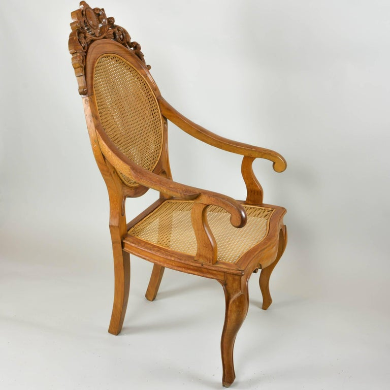 We couldn't resist picking up the carved back chair with a double caned back. The richness of the wood caught our eye and the quality of the caning made it a must have. Very comfortable with slightly reclining back and wide seat. The arms on the