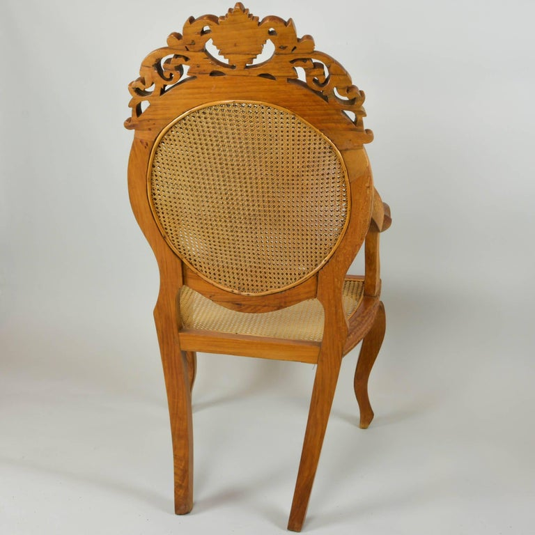 Hand-Carved Vintage Carved Accent Chair with Caned Seat and Back For Sale