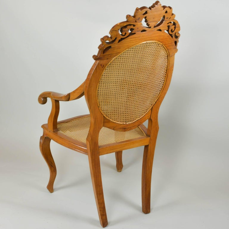 20th Century Vintage Carved Accent Chair with Caned Seat and Back For Sale