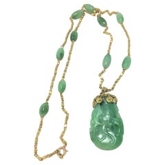 Vintage Carved Jade and 22 Karat Yellow Gold Pendant Necklace
