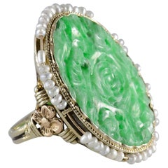 Vintage Carved Jadeite Ring Encircled with Seed Pearls 14 Karat Yellow Gold