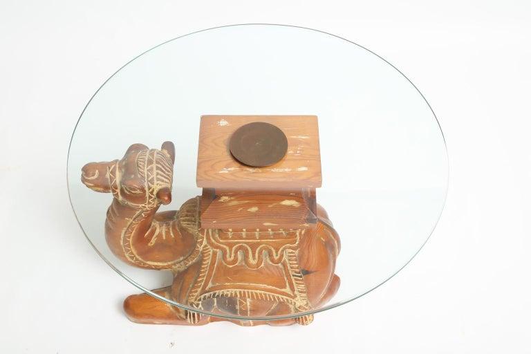 Hollywood Regency Vintage Carved Wood Camel Side Table with Glass Top For Sale
