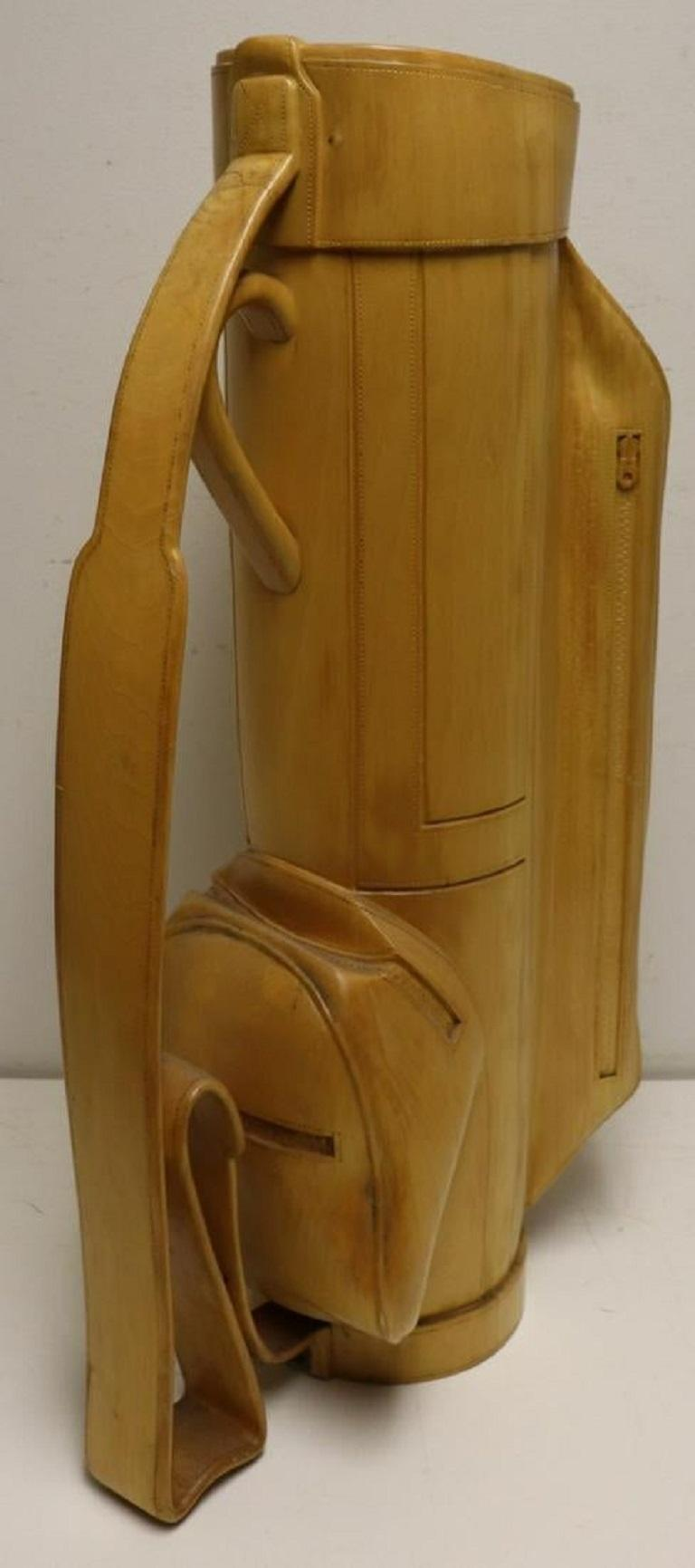 Heavily carved solid wood golf bag. Custom made and one of a kind. Nice item for a collector or golf enthusiast. Has a metal insert inside.