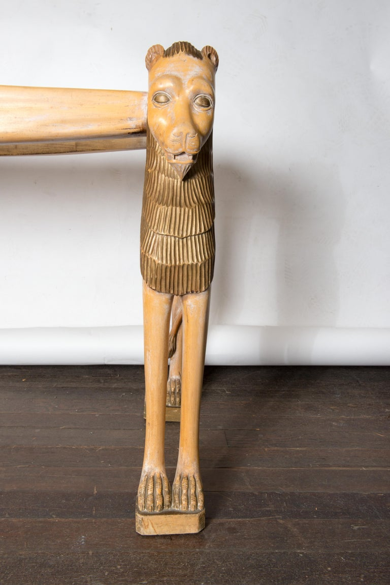 1960s vintage carved wood Egyptian Revival lion console table with an inset glass top. Nicely carved detailed lion face and mane, tail and toes.