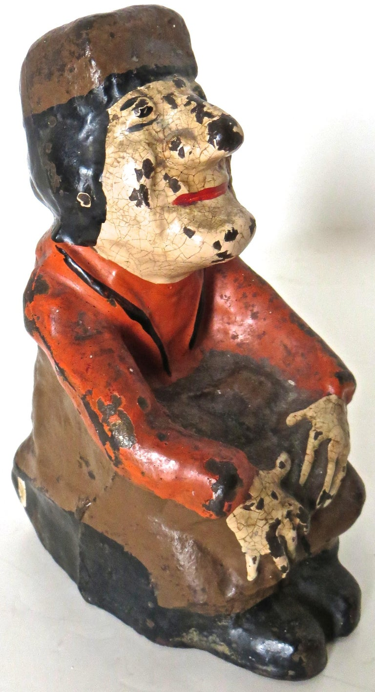 From the Alice in Wonderland series, this full figured American cast iron doorstop features the