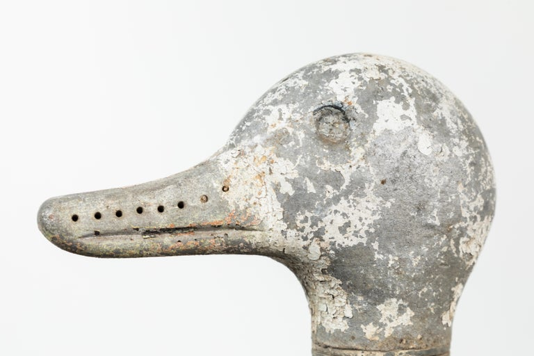 Fun vintage iron duck sprinkler. The head of this circa 1940s duck lawn sprinkler would spin as the water would shoot from holes along the top of the head and the beak.