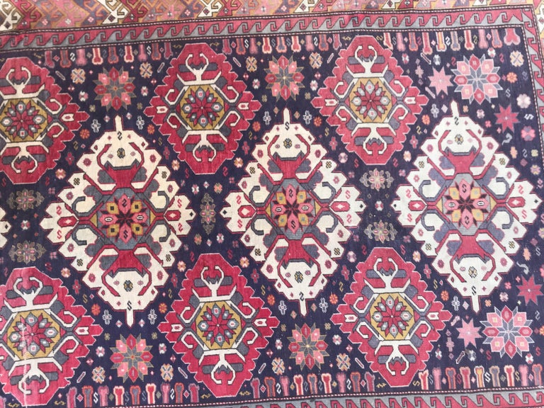 Beautiful mid-20th century large Azebaijan rug with a nice Karabagh design and nice colors with blue, orange, grey, yellow. Pink and purple, entirely hand knotted with wool velvet on cotton foundation.