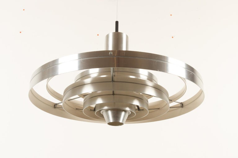 Vintage ceiling pendant Fibonacci by Sophus Frandsen for Fog & Mørup, 1960s Danish lamp in aluminium designed by Sophus Frandsen. The lamp consist of six floating rings that diffuses the light evenly in all directions. The lamp can be suspended