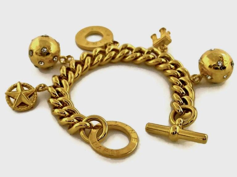 Vintage CELINE Iconic Charm Chain Bracelet  Measurements: Height: 2 inches (5 cm) Wearable Length: 7.5 inches (19 cms)  Features: - 100% Authentic CELINE PARIS. - 5 iconic Celine logo emblem charms. - Gold tone. - Toggle closure. - Signed CELINE