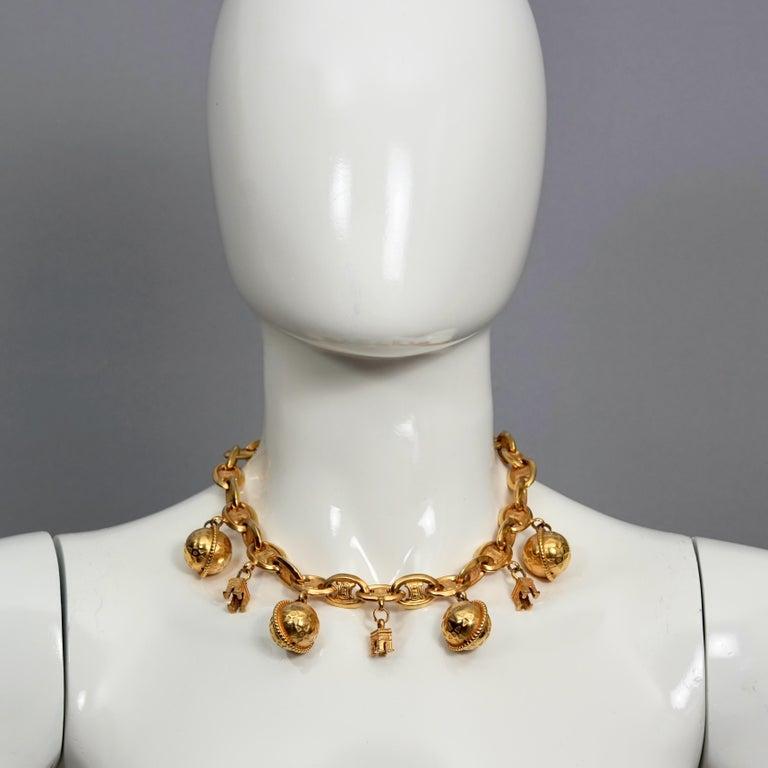 Vintage CELINE PARIS Iconic Arc de Triomphe Planet Charms Choker Necklace  Measurements: Height: 1.77 inches (4.5 cm) Wearable Length: 17.32 inches (44 cm)  Features: - 100% Authentic CELINE Paris. - Chunky choker necklace in gold tone. - Iconic