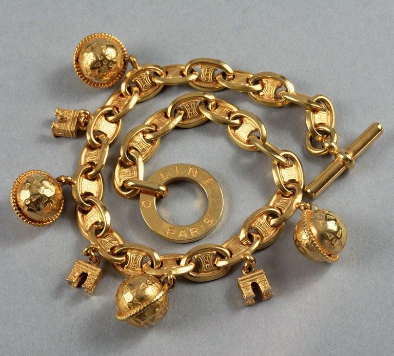 Vintage CELINE PARIS Iconic Arc de Triomphe Planet Charms Choker Necklace In Excellent Condition For Sale In Kingersheim, Alsace