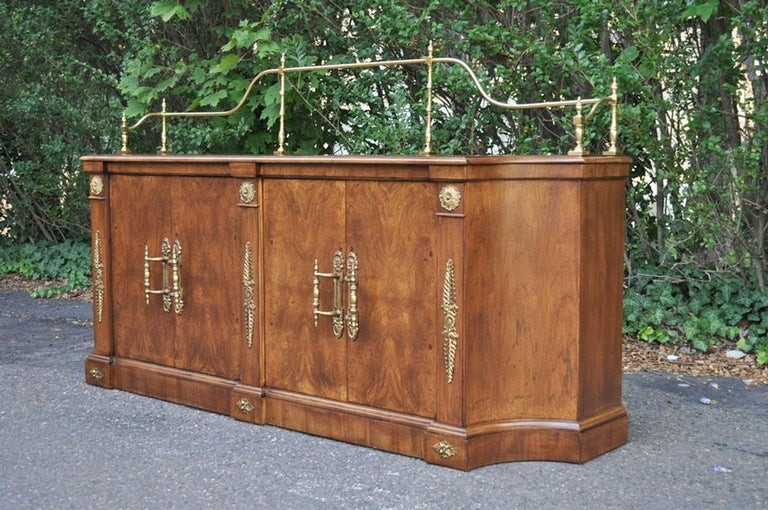 Stunning vintage French Empire / neoclassical style burl wood sideboard/credenza by Century Furniture Company. Item features warm burled woodgrain, brass hardware handles, gallery, ornate feathered ormolu accents. The piece has lower interior