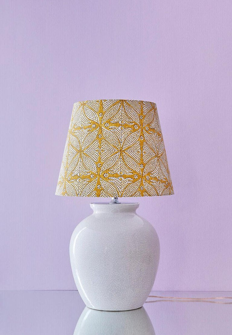 France, 1930s  Art Deco ceramic table lamp with customized shade.  Size: H 63 x Ø 38 cm.