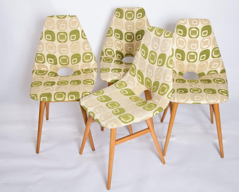 Comfortable, renovated dining chairs, set 4, 1960s. This vintage item has no defects, but it may show slight traces of use.