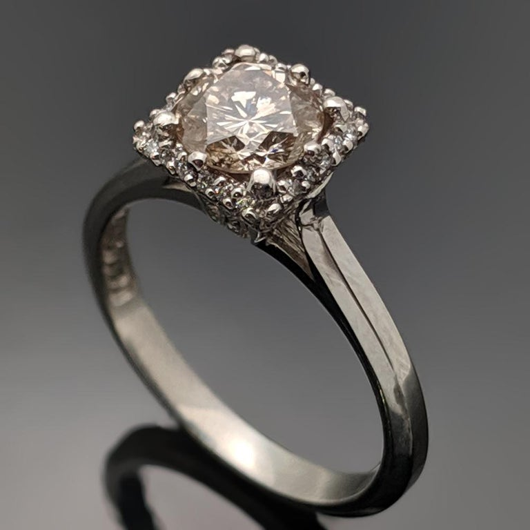 A vintage platinum ring featuring an eight pronged square setting with center, brilliant-cut Champagne diamond with an estimated weight of 0.92ct. Estimated weight of platinum 3 gr.   We will size it for you.